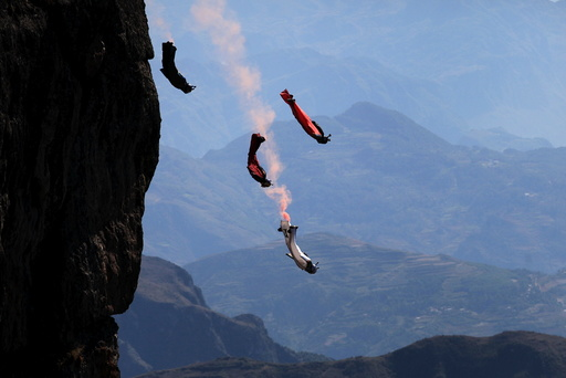 Wingsuit flyer contestants practice ahead of a competition in Zhaotong