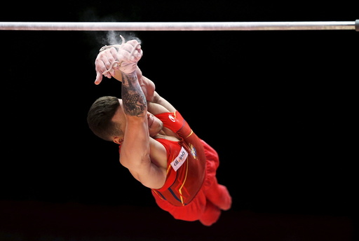 Nestor Abad of Spain falls from the High Bar during the men's qualification for the World Gymnastics Championships at the Hydro arena in Glasgow