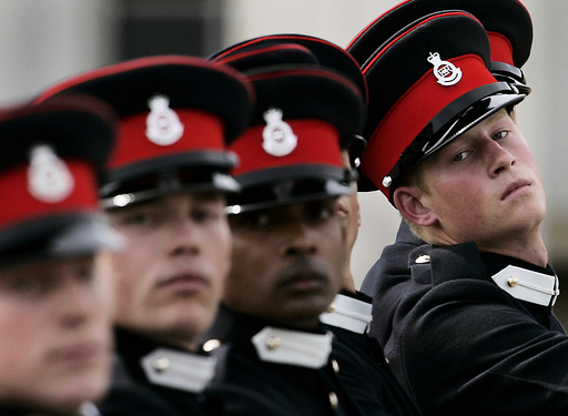 Britain's Prince Harry marches during a parade at the Royal Military Academy Sandhurst in England.