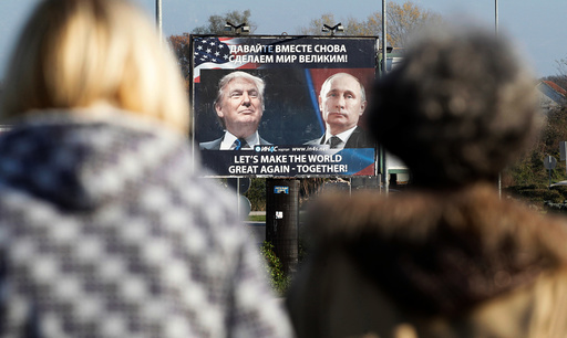 A billboard showing a pictures of US president-elect Donald Trump and Russian President Vladimir Putin is seen through pedestrians in Danilovgrad