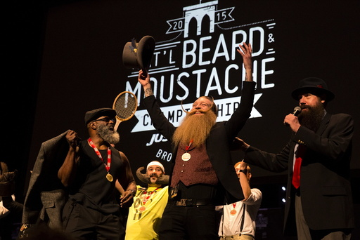 Scott Metts from Orlando, Florida, celebrates after winning the 2015 Just For Men National Beard & Moustache Championships at the Kings Theater in the Brooklyn borough of New York