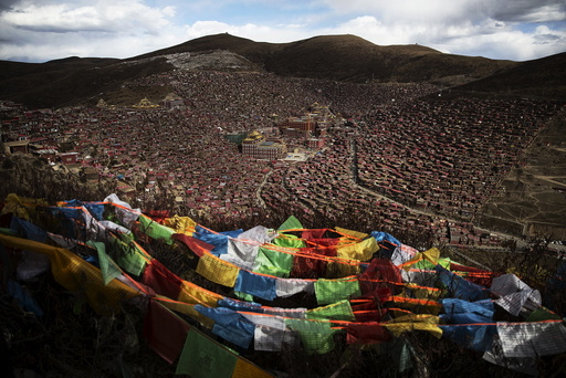 Tibetan prayer flags flutter above the Larung valley and its Larung Wuming Buddhist Institute, located some 3700 to 4000 metres above the sea level in remote Sertar county, Garze Tibetan Autonomous Prefecture, Sichuan province, China