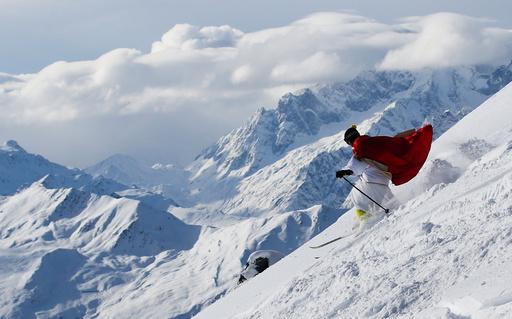 A man dressed as Santa Claus enjoys the snow during the Saint Nicholas Day at the Alpine ski resort of Verbier