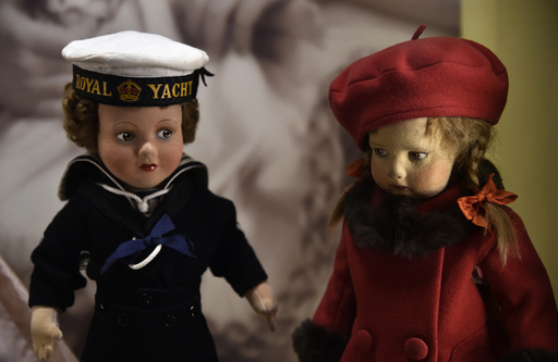 Two dolls belonging to Queen Elizabeth from her childhood are displayed at Buckingham Palace in central London