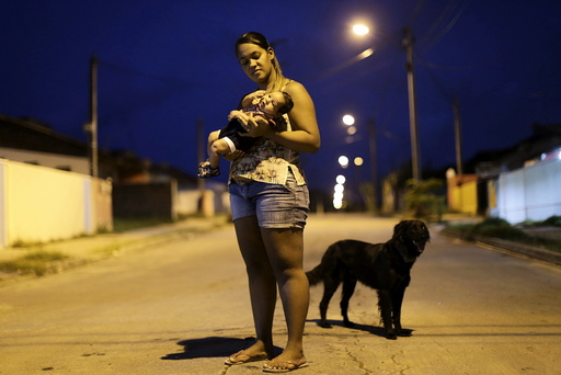 Germana Soares holds her son Guilherme Soares Amorim, who was born with microcephaly, near at her house in Ipojuca