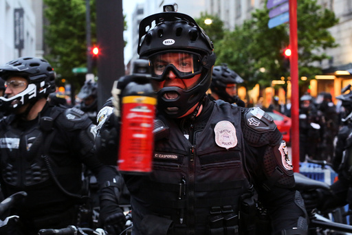 A police officer threatens to use pepper spray during May Day protests in Seattle, Washington