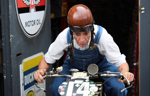 An enthusiast attends the annual Goodwood Revival historic motor racing festival near Chichester