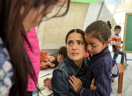 Movie star Salma Hayek meets with Syrian refugees during her visit with UNICEF to an informal settlement in the Bekaa valley