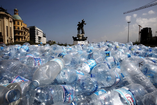 Water bottles are gathered to be recycled near a statue in Martyrs' Square in Beirut, Lebanon
