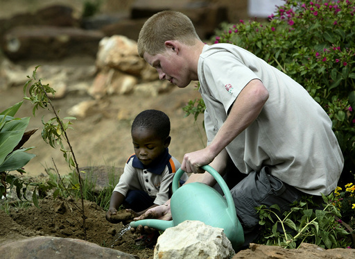 PRINCE HARRY PLANTS A TREE AT THE MANTS'ASE CHILDRENS HOME NEAR MAHLES HOEK IN LESOTHO.