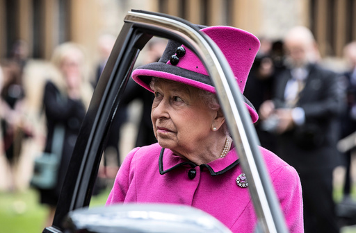Britain's Queen Elizabeth talks to recipients of new