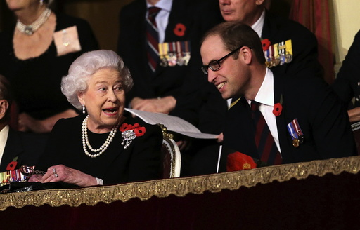 Britain's Queen Elizabeth and Prince William, Duke of Cambridge, chat with each other in the Royal Box at the Royal Albert Hall during the Annual Festival of Remembrance in London