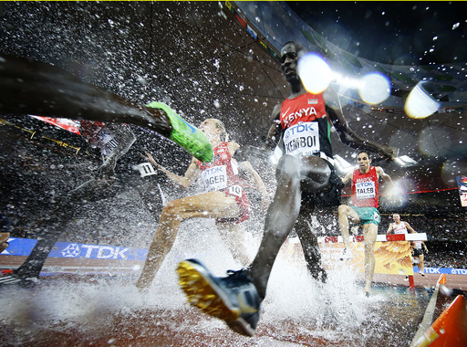 Ezekiel Kemboi of Kenya jumps a water obstacle in the men's 3000 metres steeplechase final during the 15th IAAF World Championships at the National Stadium in Beijing