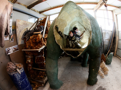 Assistants of businessman Yan-Vin-Tin create a sculpture at a workshop outside Krasnoyarsk