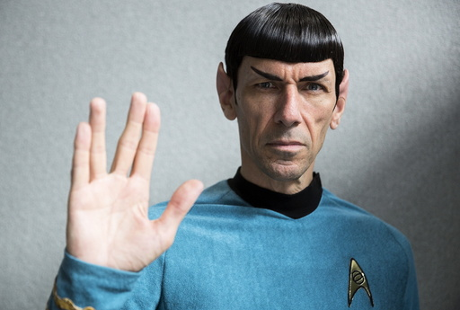 An impersonator poses in costume as the character Mr Spock from the science fiction series