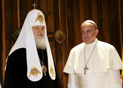 Pope Francis looks at Russian Orthodox Patriarch Kirill during their meeting in Havana