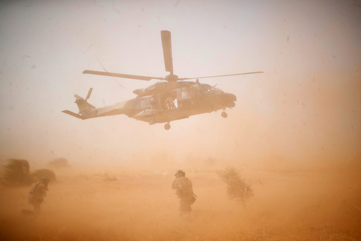 A NH 90 Caiman military helicopter takes-off during the regional anti-insurgent Operation Barkhane in Inaloglog