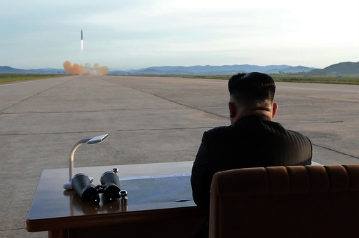 Kim Jong Un attends launching of ballistic missile Hwasong-12