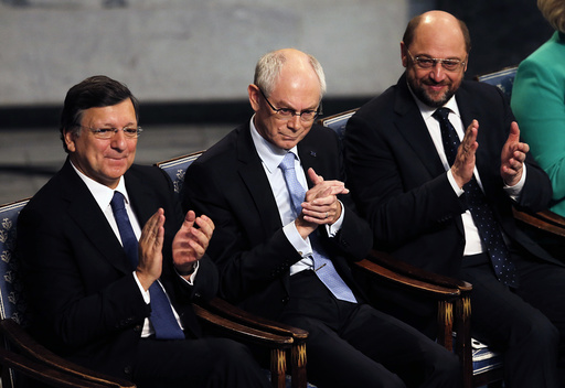 EU representatives President of the European Commission Barroso, President of the European Council Van Rompuy and President of the European Parliament Schulz applaud during the ceremony for the Nobel Peace Prize which they accepted on behalf of the E