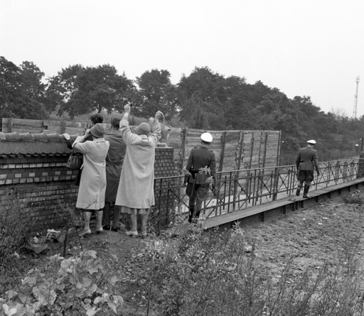 Families wave at their relatives across Berlin Wall