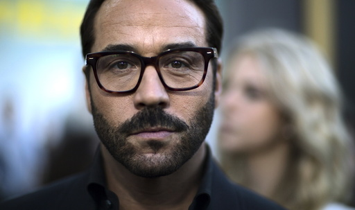 Cast member Piven poses at the premiere of
