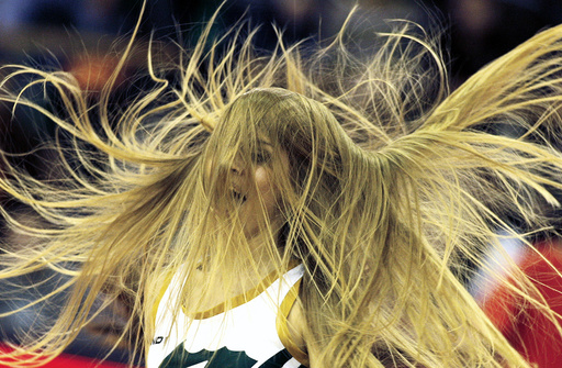 A cheerleader performs during a Euroleague basketball match in group A in Ljubljana