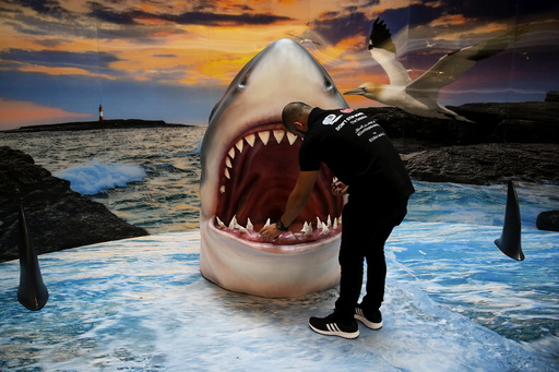 A man checks a shark display at the Dubai Mall