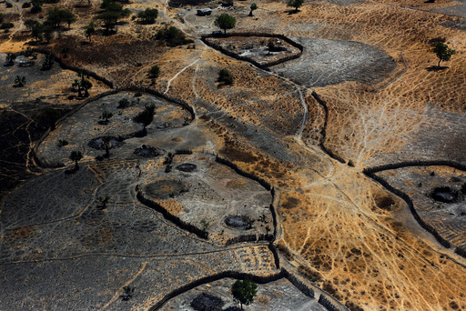 An aerial view shows the remains of burnt homes from what residents said was the latest attack by armed men in Thonyor, Leer County