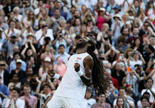 Dustin Brown of Germany celebrates after winning his match against Rafael Nadal of Spain at the Wimbledon Tennis Championships in London