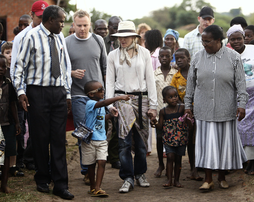 Madonna and her children David and Mercy visit the Mphandula Child Care Centre