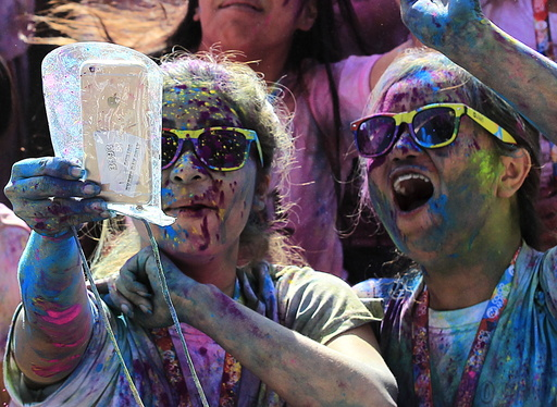A runner takes a selfie photo while celebrating during a