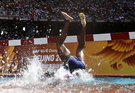 Rolanda Bell of Panama falling head first into the water obstacle during the women's 3000 metres steeplechase heats at the 15th IAAF World Championships in the National Stadium in Beijing