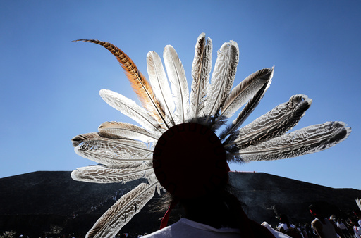 A dancer takes part in a ceremony to welcome the spring equinox in front the Pyramid of the Sun in the pre-hispanic city of Teotihuacan, on the outskirts of Mexico City