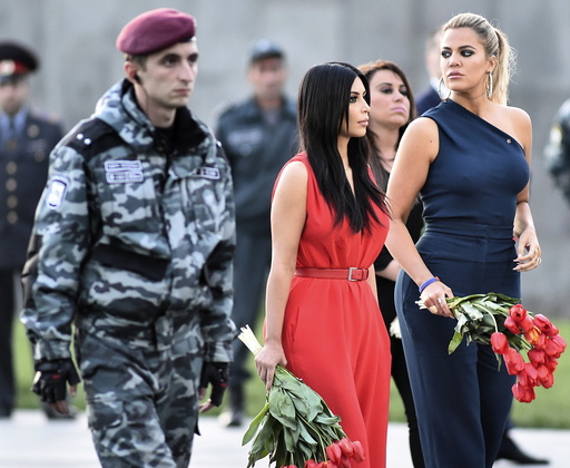 U.S. television personalities Kim and Khloe Kardashian attend a flower laying ceremony at the Tsitsernakaberd Armenian Genocide Memorial Museum in Yerevan