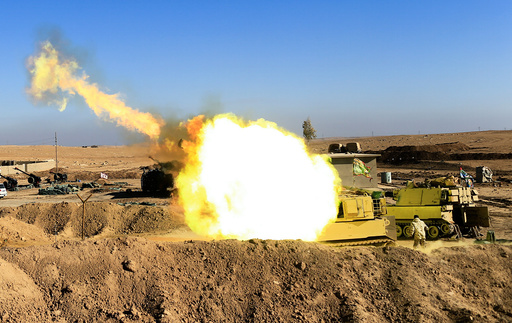 Iraqi army fires towards Islamic State militant positions in Mosul from the village of Adhbah