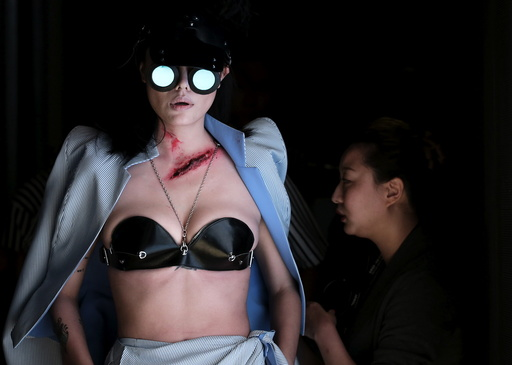 A model waits to present a creation by Chinese designer Hu Sheguang during China Fashion Week S/S 2016 in Beijing