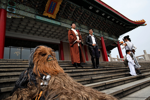 Fans dressed as the characters from Star Wars react during Star Wars Day in Taipei