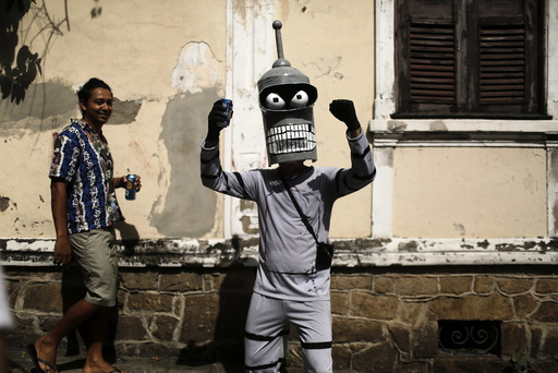A reveller poses for a photo as he takes part in an annual block party known as Ceu na Terra , in Rio de Janeiro