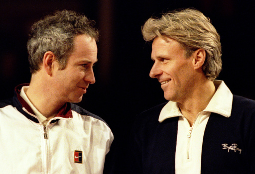 MCENROE AND BORG SHARE A MOMENT BEFORE THEIR MATCH