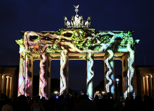 The Brandenburg Gate is illuminated during the Festival of Lights show in Berlin