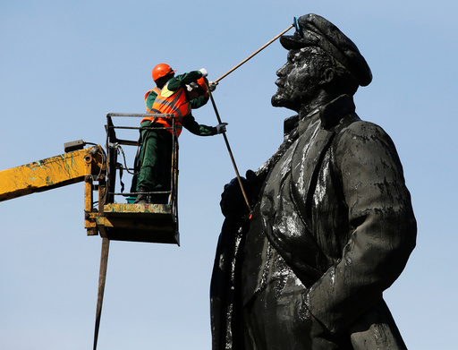 Workers wash a statue of Soviet state founder Lenin in Krasnoyarsk