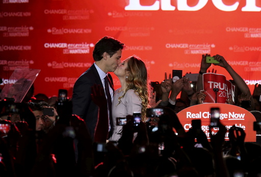 Liberal Party leader Justin Trudeau kisses his wife Sophie Gregoire as he arrives to give his victory speech after Canada's federal election in Montreal