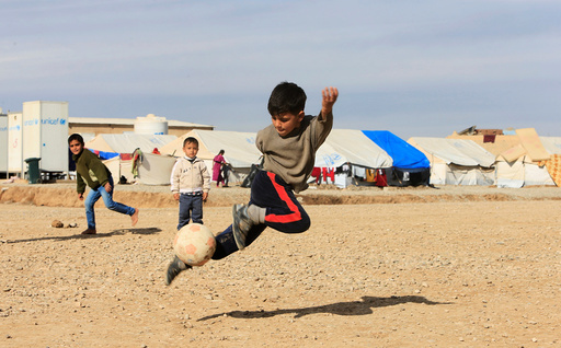 Displaced Iraqi children, who fled the Islamic State stronghold of Mosul, play at Khazer camp