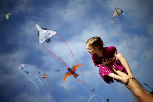 Klonoski sits on her father's leg at a kite festival in Redondo Beach