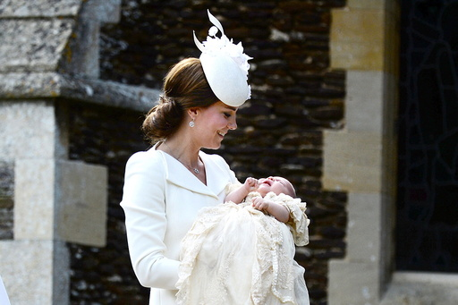 Norfolk, England, July 5th: The Duchess of Cambridge carries her daughter Princess Charlotte into the Church of St Mary Magdalene on the Sandringham Estate for the princess's christening, on July 5th 2015. The Duchess and her daughter were accompanie