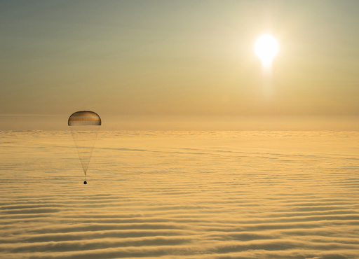 The Soyuz TMA-14M capsule with ISS crew members Barry Wilmore of the U.S., Alexander Samokutyaev and Elena Serova of Russia is seen above clouds as it descends before landing southeast of Dzhezkazgan