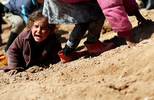 A displaced Iraqi girl cries before entering Hamam al-Alil camp, as Iraqi forces battle with Islamic State militants, south of Mosul