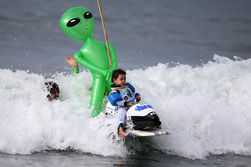 Oliver Quiros, 3, competes dressed as an astronaut in a space shuttle in the Haunted Heats Halloween Surf Contest in Santa Monica