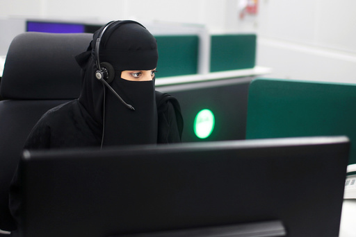 A Saudi woman works inside the first all-female call centre in the kingdom's security sector, in the holy city of Mecca