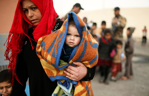 Displaced Iraqis who had fled their homes wait to move to a safe place, as Iraqi forces battle with Islamic State militants in western Mosul